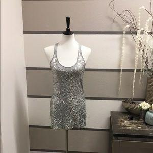 Silver sequin racerback blouse.